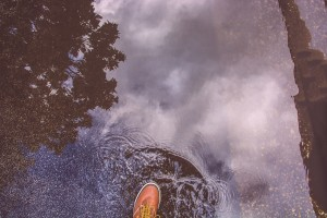 Hiking boots in puddle